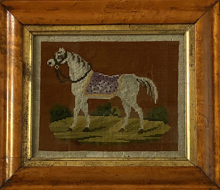 Naive needlework of a white horse in a landscape, probably American
