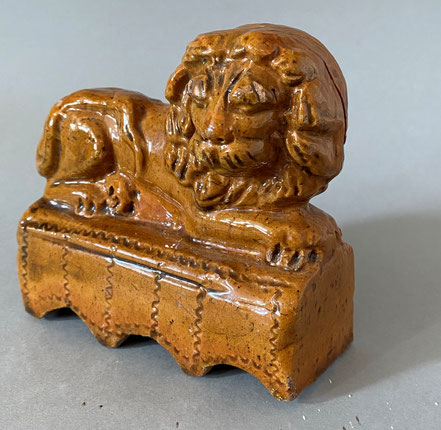 A Folk Art primitive pottery model of a lion upon a plinth.  Possibly Devon or Somerset. Early 19th century