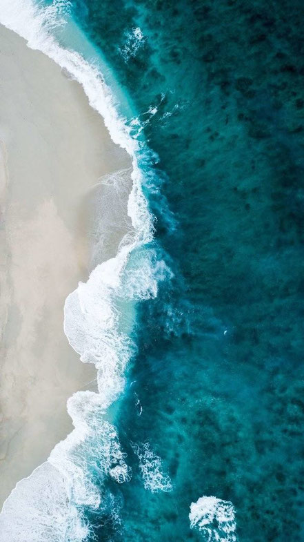 Ariel view of waves on the beach