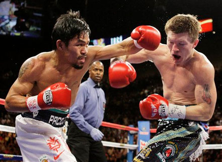 © AP Photo/ Jae C. Hong. Quelle: http://www.odt.co.nz/sport/boxing/53933/boxing-pacquiao-destroys-hatton-two-rounds