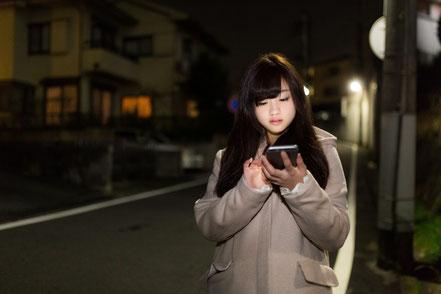 腰痛に悩む奈良県大和高田市の女性
