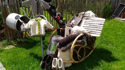 Wollprodukte Filztaschen Körbe Filzschuhe kardierte Wolle
