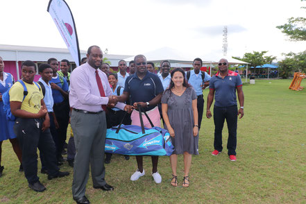Cricket Kindness Ambassador, Sir Richie Richardson and founder, Tamara Lowe present equipment to Principal Ashworth Azille at Clare Hall Secondary in ANTIGUA during the inaugural Cricket Kindness Mission in 2017!