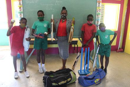Principal Leah Samuel and students at CT Samuel Primary School in Antigua.