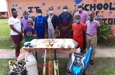 Cricket Kindness Ambassadors, Sir Richie Richardson (navy shirt) and Antigua Sports Commissioner, Hon. Colin James (pink shirt) donate kit to JT Ambrose School, Antigua.