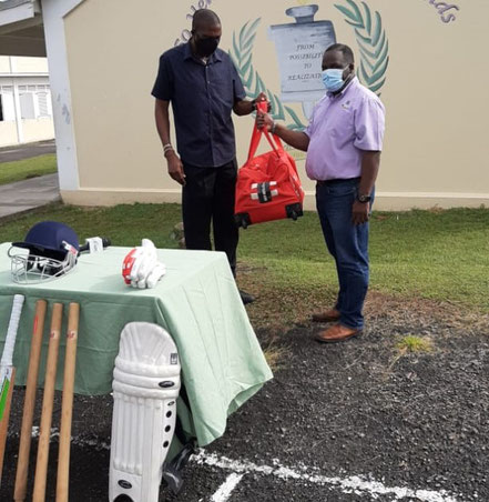 Sir Curtly Ambrose presents equipment donation on behalf of Cricket Kindness to principal Orson James at All Saints Secondary on Jan 13, 2021