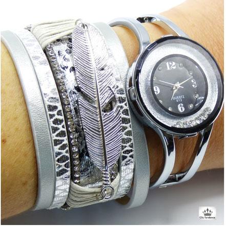 bracelet manchette cuir argenté avec plume strass chrome et peau de serpent