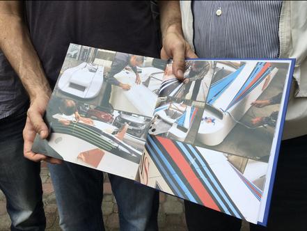Il libro aperto sulle pagine che mostrano la lavorazione eseguita da PubbliMais per il ripristino completo della grafica Martini