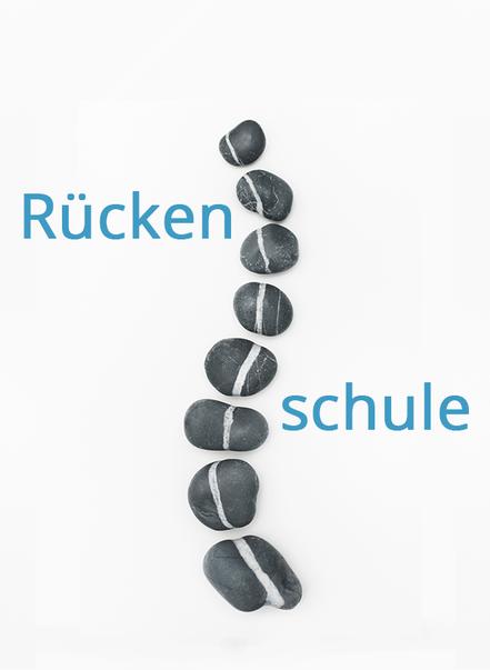 Kieselsteine bilden eine stilisierte Wirbelsäule nach als Symbol für die Rückenschule. Bild Friedberg/Fotolia