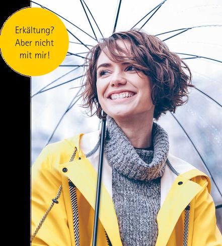metavirulent Frau mit Regenschirm im Friesennerz