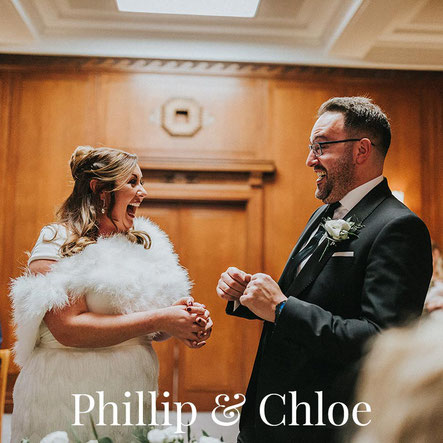 bride and groom saying I do and laughing