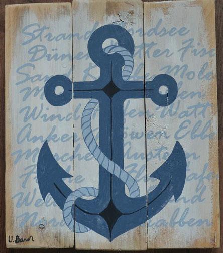 Anker auf Holz unterlegt mit maritimen Begriffen
