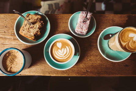 A table of coffee and cake from a cafe in Amsterdam