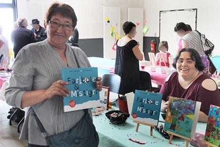 Lectrice Mme Mur, présidente du club des anciens lectrice de Faribole et Mistigri paru chez YIL Édition