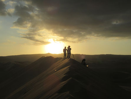 Sunset on the dunes in Huacachina