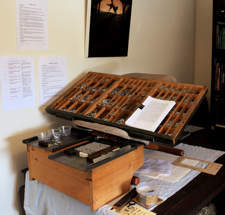 My first typesetting rig: an old cupboard coupled with an ergonomic chair