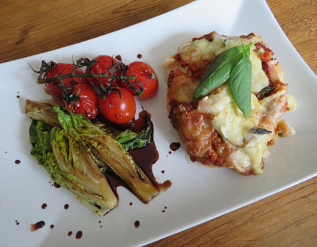 Vis ovenschotel van stevige witvis, pesto, mozzarella en Parmezaanse kaas.