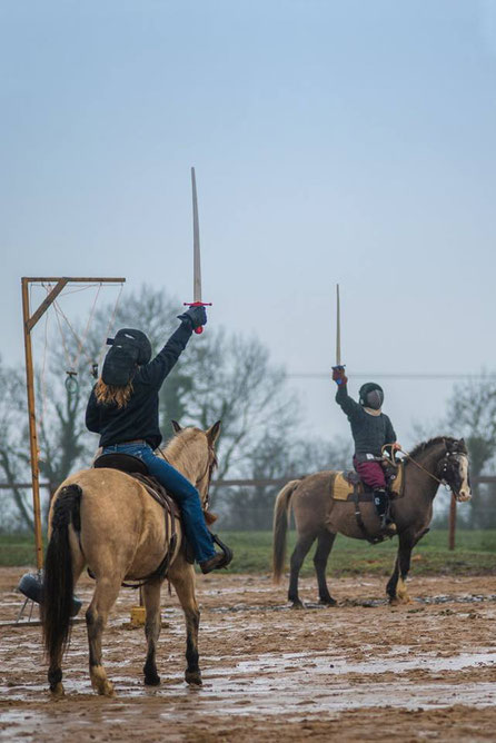 The Horsemen during a mounted combat demo