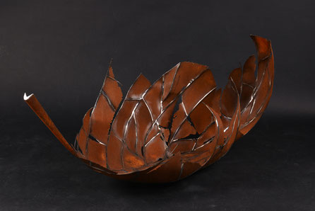 Big sculpture of a fallen leaf, made of stainless and cortensteel. Unique exemplar.