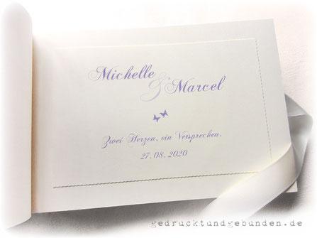 Fotoalbum Hochzeit, Hardcovereinband mit Schmuckpapier floral in creme und lila, Buchblock elfenbeinfarben, 50 Blatt/100 Seiten mit Pergaminzwischenblättern, Schleifenverschluss