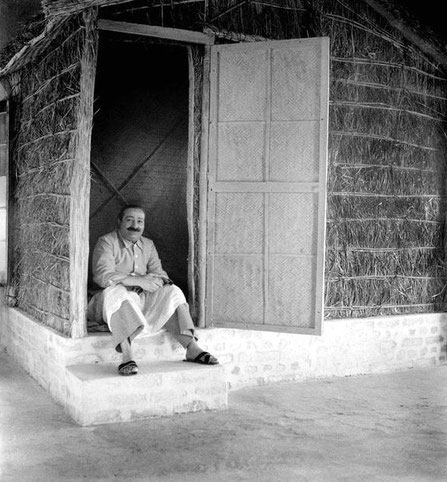 Feb.-March 1947 : Meher Baba outside the seclusion hut, the Hamam Khana Cottage. Image courtesy of Lord Meher - Vol.9-10, p. 3151.