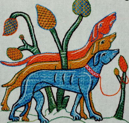Three stylised embroidered hounds, in orange, bright orange and blue, standing in front of a stylised tree.