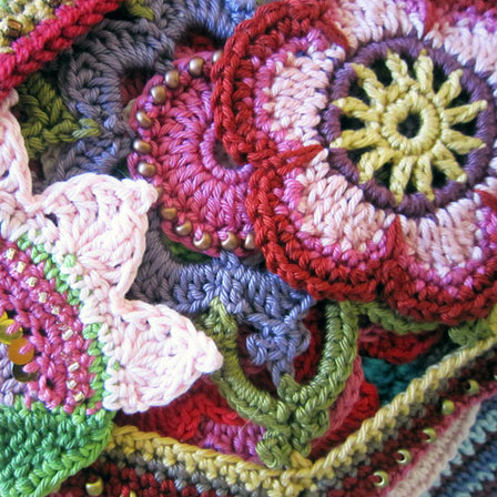 Brightly coloured crocheted flowers.