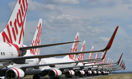 Will they take off again? Grounded Virgin Australia aircraft at Brisbane Airport. Image: Darren England/AAP