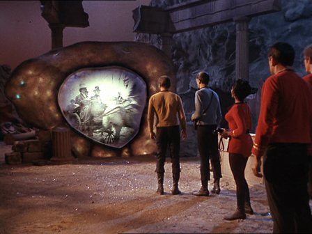 "Still from Episode 28 of Star Trek called ""The City on the Edge of Forever"".  Still shows crew of USS Enterprise looking through the time travel device known as the Guardian of Forever, and seeing images of the past."