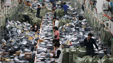 Higher postal fees for China's e-commerce packages