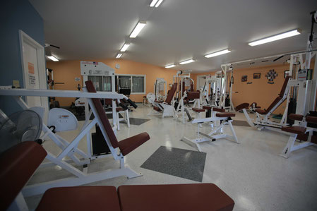 Fitness equipment in Burpee & Mills gymnasium.