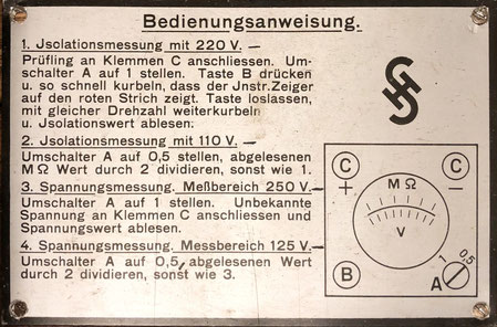 Operation manual inside the cover of the antique siemens and halske insulation meter