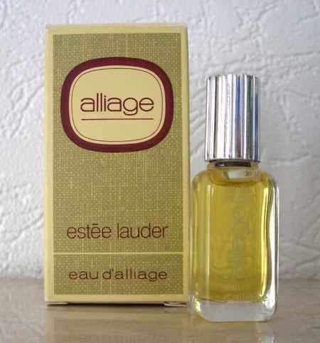 3)  ALLIAGE - EAU D'ALLIAGE - BOUCHON ARGENTE STRIE
