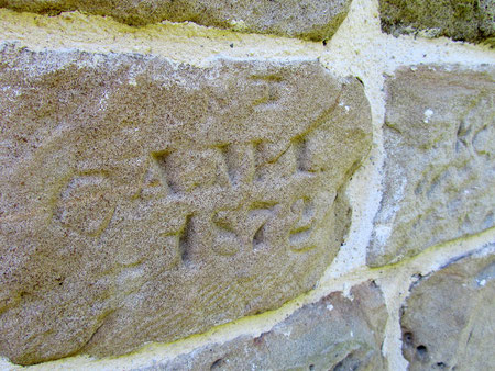 Graffiti on the east wall of the chancel may be the mark of the builder who 'restored' the Norman slit window.