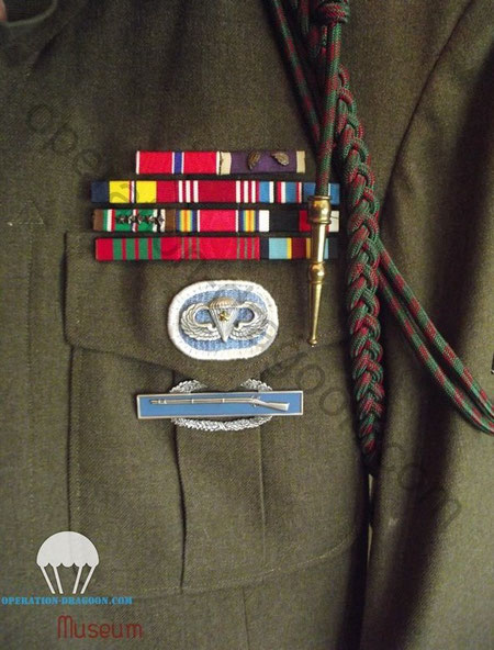Bar medals, parachute wings and combat infantry badge on Gary DAVIS jacket