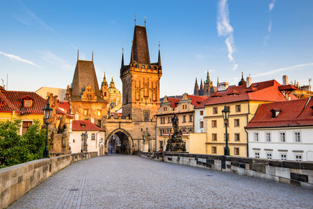 Best things to do - Prague, Czech Republic. Charles Bridge with its statuette, Lesser Town Bridge Tower and the tower of the Judith Bridge. Copyright Emi Cristea