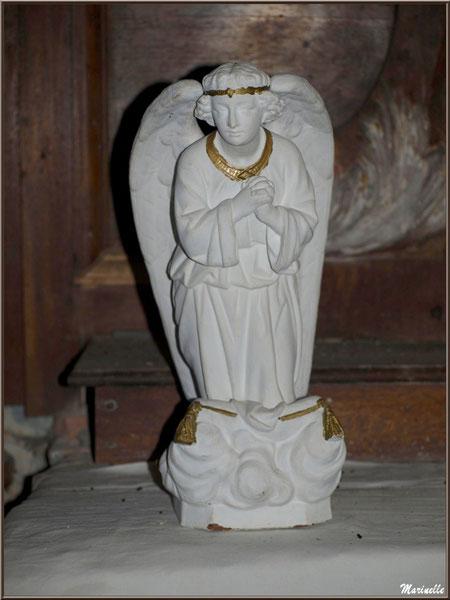 Un des deux anges sur l'Autel de la Vierge, église Saint Pierre de Mons à Belin-Beliet (Gironde)