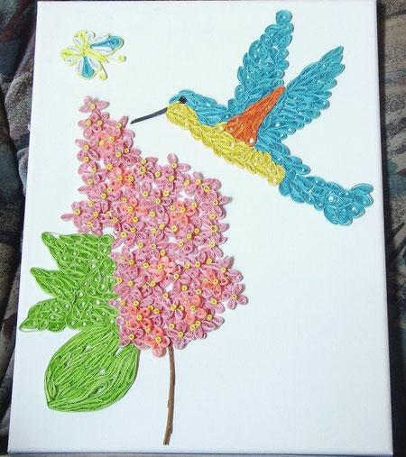 Bluetendolde mit Kolibri