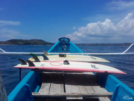 With the boat to the surfspot Gerupuk