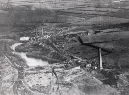 Aerial view of Randlay Brickworks, Chemical Works and Randlay Pool c1914 just north of Stirchley. Image from South Telford Heritage Trail website http://www.walktelfordheritage.co.uk. Personal and educational use permitted.
