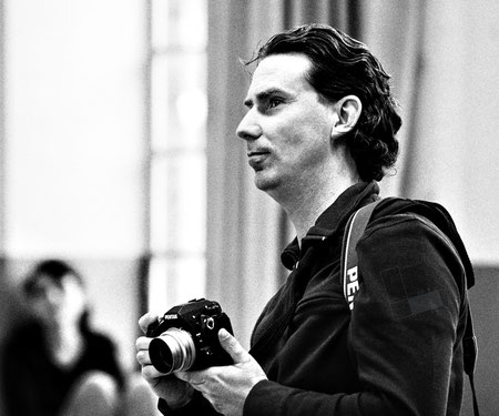 Der Fotograf mit Kamera