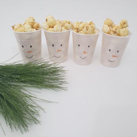 Kerstdiner op school, popcorn, traktatie, sneeuwpop