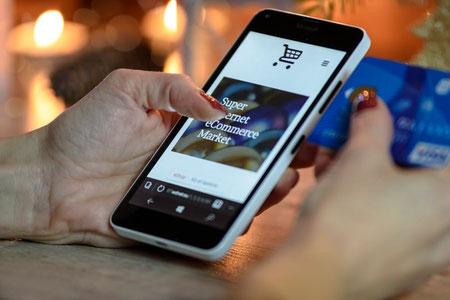 Online winkelen, koopverslaafd, mobiele telefoon.