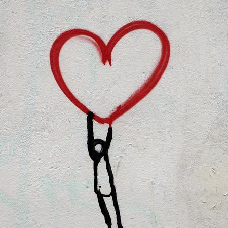 Graffiti, adoptie, kind aan hart.