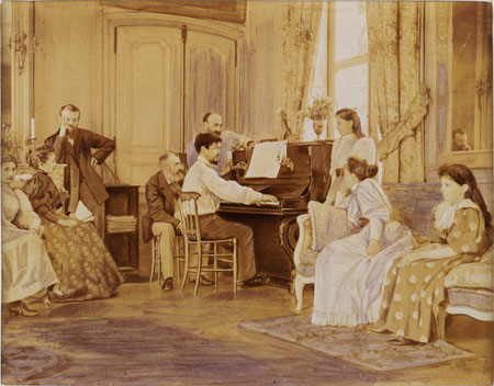 Debussy al piano. Tras él, el compositor Ernest Chausson, 1893. (Albumen print enhanced with violet ink, mounted on cardboard, August 1893 -photographer unknown-)