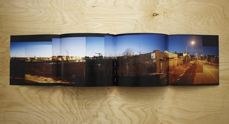 Folded-out double gatefold spread displaying a panorama of photographs of a UFO graffiti painting on a building in Brooklyn.