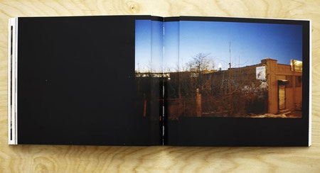 Folded-in double gatefold spread displaying a single photograph of a UFO graffiti painting on a building in Brooklyn.