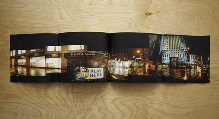 Folded-out double gatefold spread displaying a panorama of photographs of a UFO graffiti painting on a newsstand in Manhattan.