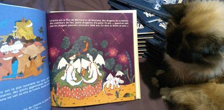 Aperçu d'une île et d'une famille de dragons sur une page de l'album jeunesse Le rhume de Liharina la dragonette
