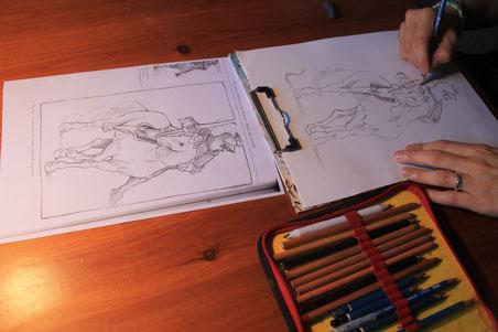 Giorgia mentre disegna il cavallo con cavaliere rovesciato